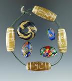 Set of eight early Venetian type trade beads.