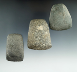 Set of three stone tools found in Michigan including two Celts and an Adze. Largest is 2 1/2