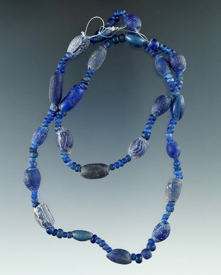 """18"""" Strand of attractive blue Beads all found in Macon Co., Alabama from the doctor Burke."""