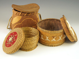 Set of three baskets, one from bark, one from pine needles and one with quill work.