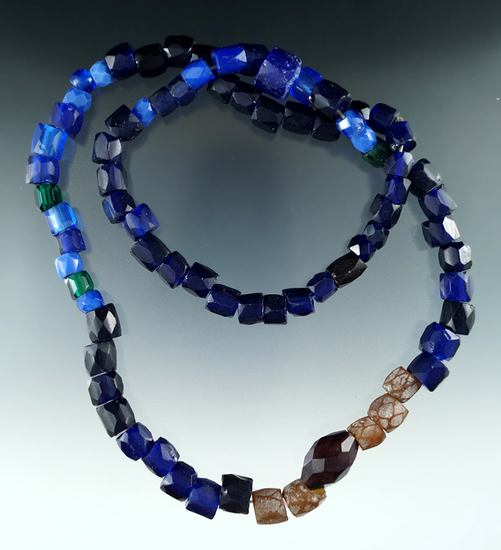 """Trade Beads. A Columbia River trade item, this strand of 'Russian' faceted Glass Beads is 27""""L."""