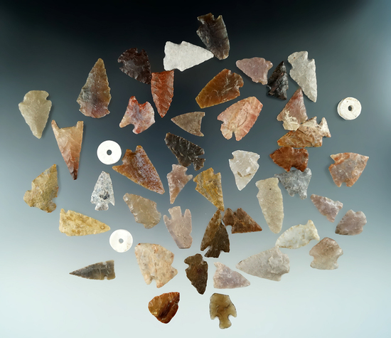 """Large group of 43 High Plains arrowheads and three shell beads, largest is 1 3/8""""."""