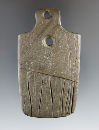 """2 7/8"""" Eclectic Gorget that is heavily engraved, made from Banded Slate. Found in Clark Co., Ohio."""
