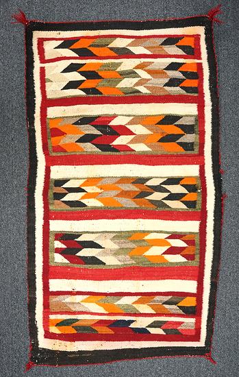 """47"""" by 26"""" Navajo rug in fair condition."""