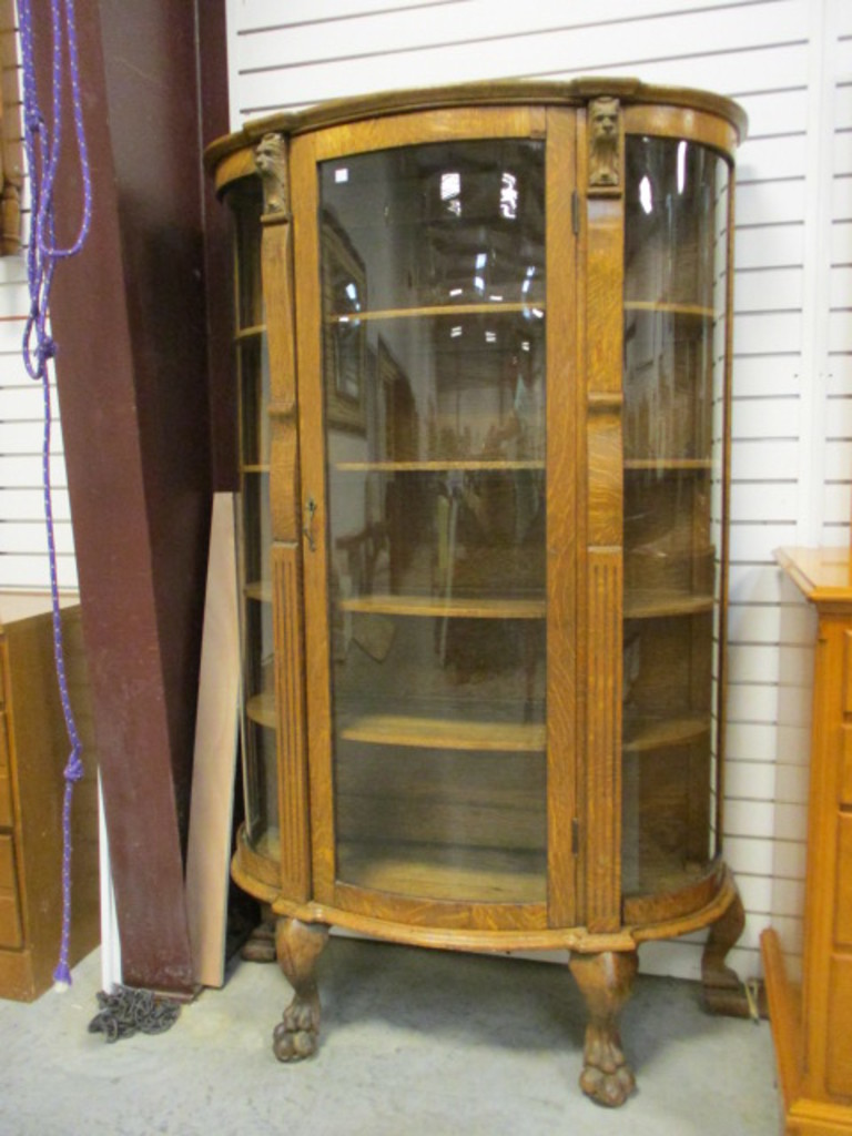 Oak Curved Curio Cabinet With Lion Heads And Claw Feet