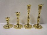 Four Baldwin Brass Candle Holders
