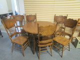 Round Table with Two Leaves and Six Oak Gingerbread Style Chairs