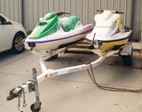 Pair of Seadoo Bombardier Jet Skis on Double Trailer