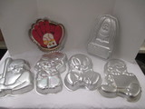 Six Wilton Cake Pans-Baseball Glove, Baseball Batter, Cowboy, Smurf, Cathy and Tweety Bird
