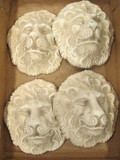 Four Plaster Lion Head Wall Plaques