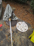 Two Metal Umbrella Stands and Patio Umbrella