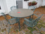 Round Green Metal Pebble Glass Top Table and Four Green Metal Mesh Chairs