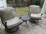 Pair of Swiveling/Rocking Metal Chairs with Removable Cushions and