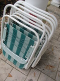 Four Aluminum Folding Chairs