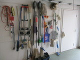 Contents of Peg Board-Cleaning Mops/Sweepers, Yard Tools, Pecan Cage, etc.