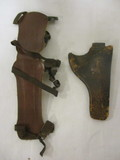 Old leather holster & Archery forearm guard
