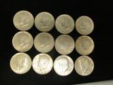 Lot of (12) Kennedy Half Dollars