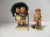 Two Hummel Figurines - Boy & Girl Under Umbrella and Girl Darning Sock
