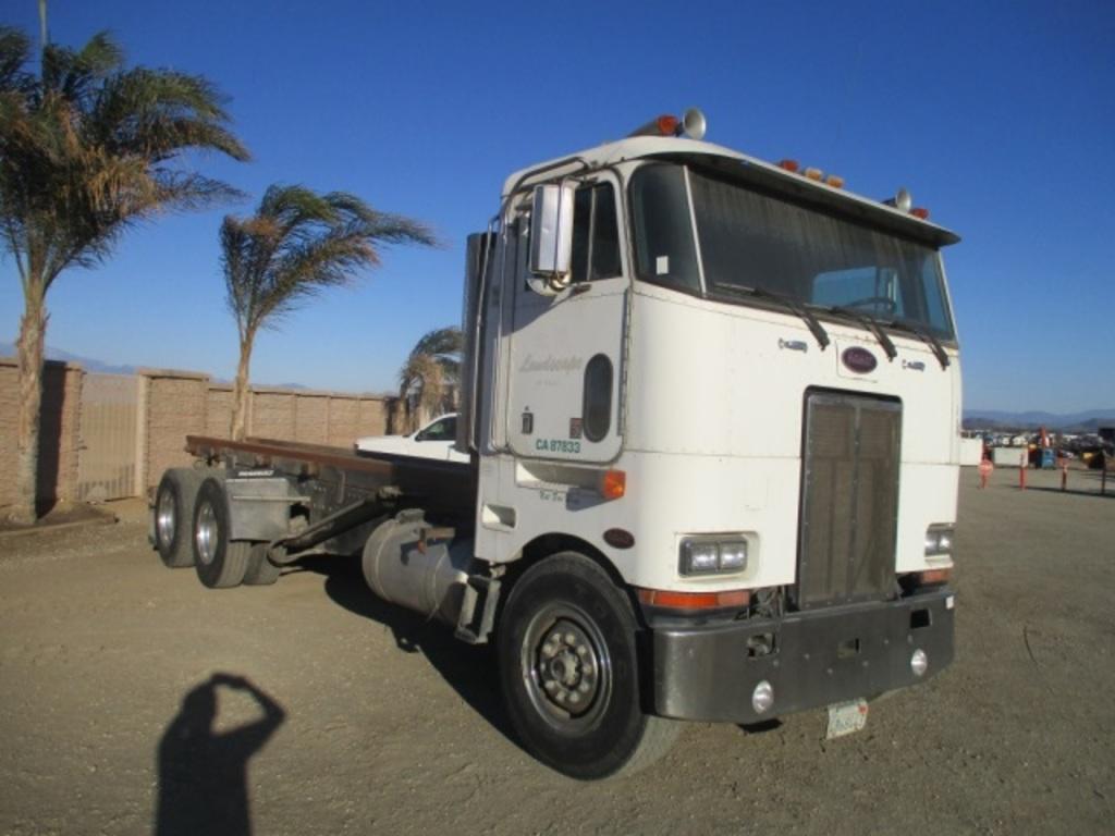 Lot: Peterbilt 362 COE T/A Roll-Off Truck,   Proxibid Auctions