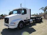 2013 Volvo VNM64T-200 T/A Roll-Off Truck,