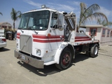 Volvo WX S/A Dumpster Truck,