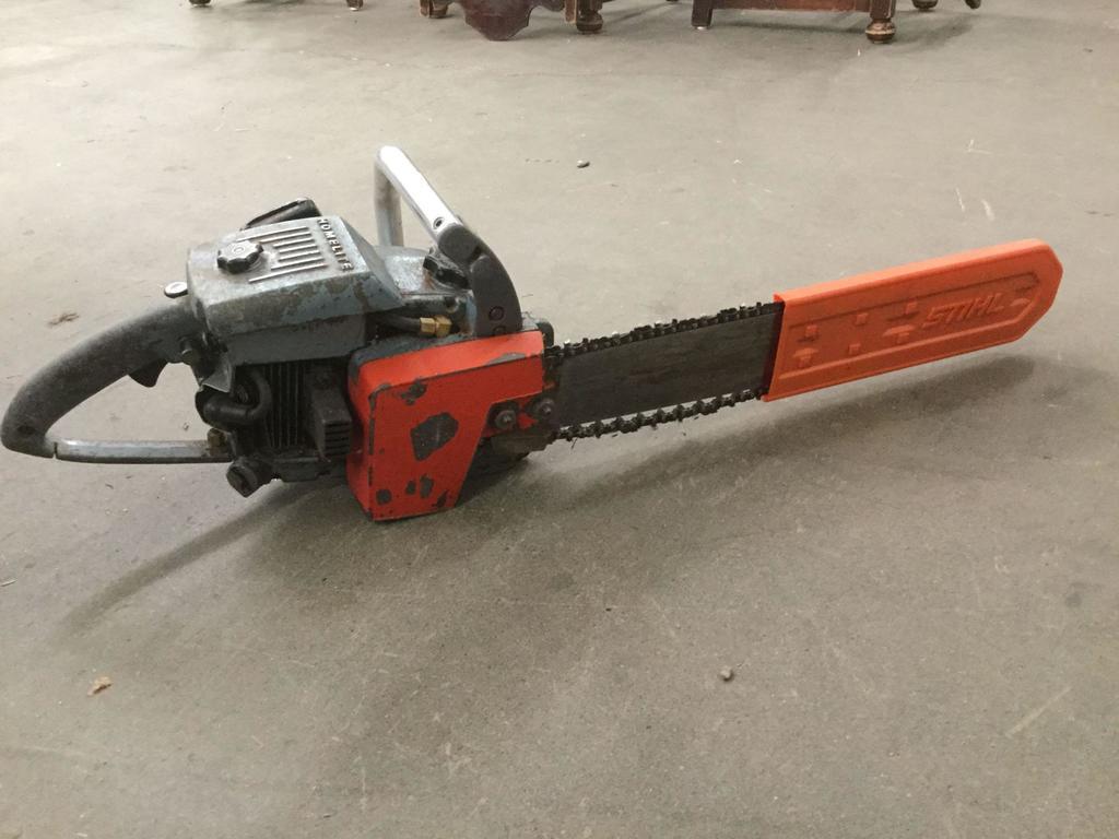 Lot: Homelite XL-12 chainsaw w/ guard   Proxibid Auctions