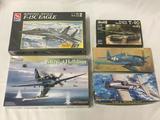 5 model kits, 1/72 scale. SEALED AMT/ERTL McDonnell Douglas F-15C Eagle, WingTech SB2C-4 Helldiver,