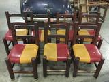 Set of 7 matching wood chairs with red/gold vinyl seats