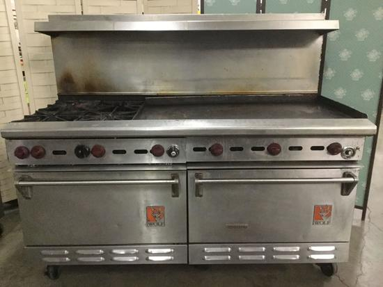 2 Wolf Ovens with 4 Burner Stove Top and Flat Grill Top. 57 x 67 x 37 inches
