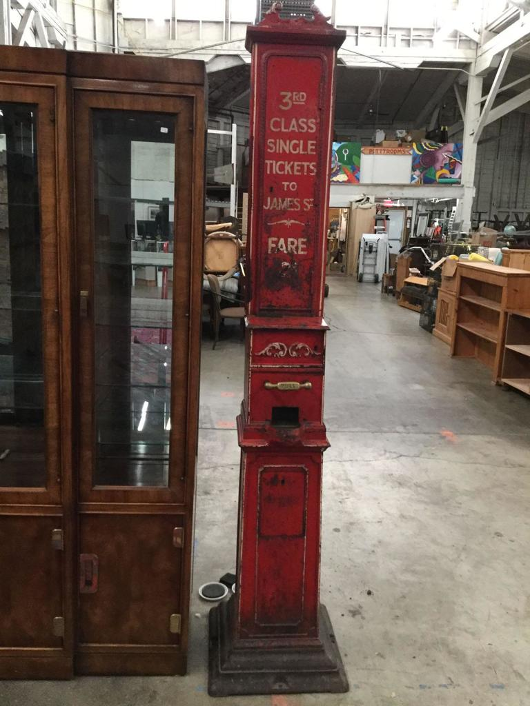 "Antique 1800's English ticket vendor machine, ""3rd Class Single Tickets to James St. - Fare 2 cents"""
