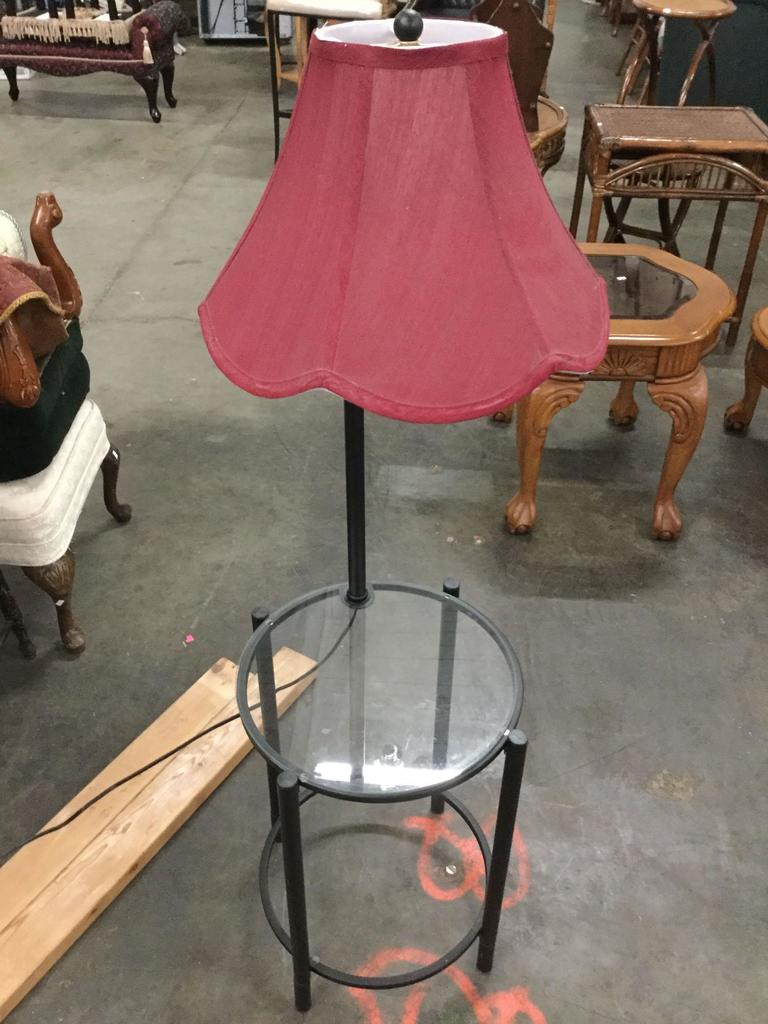 Lamp table with shade and glass surface, tested and working, approx 53 x 16 inches.
