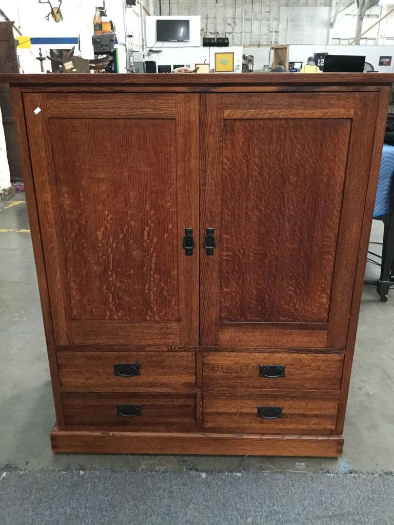 Large wooden mission style entertainment center with 4 drawers