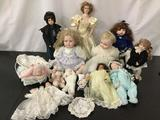 Lot of 14 baby/ girl dolls; porcelain heads and limbs Largest approx 22 inches Princess Diana
