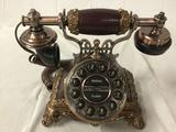 Modern rotary-style push button telephone, approx 9 x 7 inches