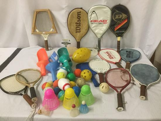 Large collection of Racquetball rackets, balls, frisbee, badminton birdie and more sports equipment