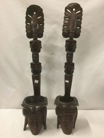 Pair of ornate Indonesian/Islander carved male/female head and totem style figures