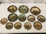 12 Vintage Ceramic and Resin Sculptured Plates of Buildings and Castles. One is chipped