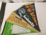 4 vintage and modern Washington state sports team pennants
