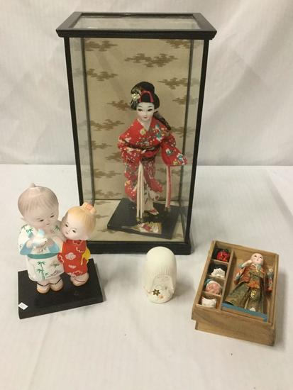 4 Vintage Asian Figures, 1 in shadowbox, x2 Ceramic Statues, and 1 porcelain doll with 4 masks and