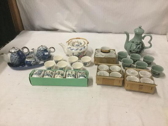 3 Japanese Tea Sets and 5 Hand-painted Japanese tea cups and 12 Gilt napkin rings