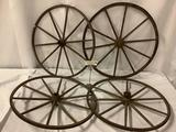 Lot of 4 antique wood/ metal wagon wheels - approx 24 inches each