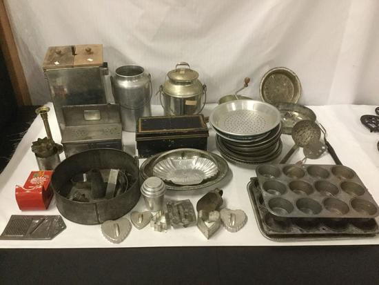 Large collection of assorted vintage Metal Kitchenware. Muffin Pans, Pie Pans, Cookie Cutters, Jars,