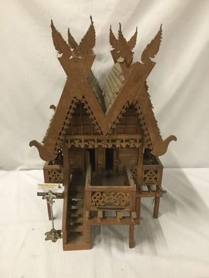 Vintage finely decorated antique Euro style model cabin on stilts with dual roof and wing toppers