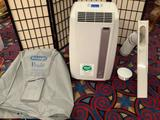 Delonghi - Pinguino air conditioner with remote control, owners manual, cover & more