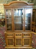 Modern Pecan china cabinet with glass windows/shelves, lighted top - marked Laconia