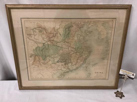 Professionally framed tinted map of mainland China drawn and engraved by J. Bartholomew
