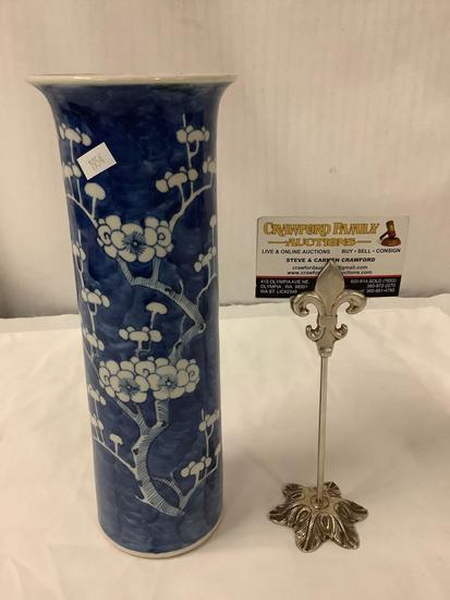 Antique ceramic blue/white vase with flowering tree design