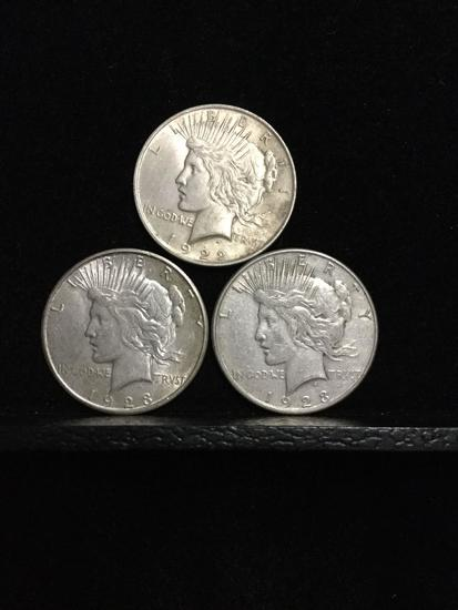 Collection of 3 silver Peace Dollars. Featuring two 1923S coins and one 1922