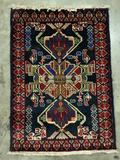 Hand made Native American small wool rug with vibrant design