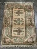 Vintage handmade C. Milas Turkish wool rug with fringe - neutral tones with floral design